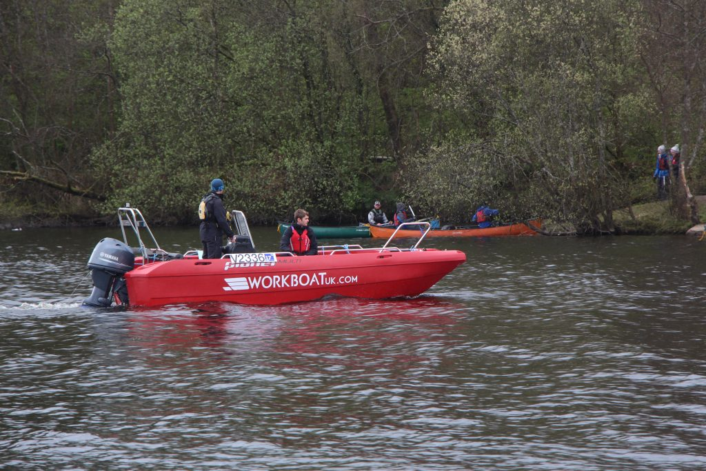 Workboat Multi supporting IYE paddlers
